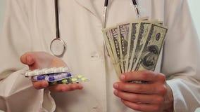 Medicinska kostnader, korrumperad vårdsystem, försäkring, bestickning arkivfilmer