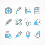 Medicinska symboler i blått Arkivbild