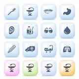 Medicinska symboler på färgknappar. Royaltyfri Bild