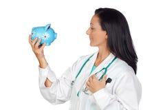 Medico adorabile con la soldo-casella fotografie stock libere da diritti