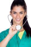 Medico attraente della donna con l'uniforme di verde Fotografie Stock