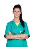 Medico attraente della donna con l'uniforme di verde Immagine Stock