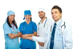 Medico che presenta la sua squadra Fotografia Stock