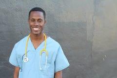Medico che sorride con lo spazio della copia Fotografia Stock
