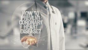 Medico che tiene a disposizione come impedire coronaropatia Immagine Stock Libera da Diritti