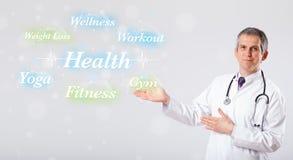 Medico clinico che indica la raccolta di forma fisica e di salute del wor Fotografia Stock Libera da Diritti
