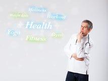 Medico clinico che indica la raccolta di forma fisica e di salute del wor Immagini Stock