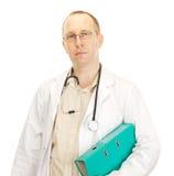 Medico con i documenti circa un paziente Fotografie Stock Libere da Diritti