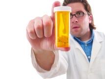 Medico con la bottiglia di prescrizione fotografia stock