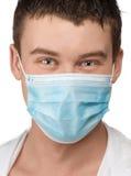 Medico con la mascherina chirurgica Fotografia Stock