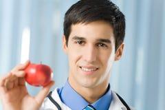 Medico con la mela Fotografie Stock