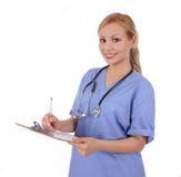 Medico con lo stetoscopio ed i appunti Immagini Stock