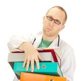 Medico con molto lavoro Fotografia Stock
