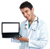 Medico con un computer Immagine Stock Libera da Diritti