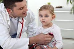 Medico con un paziente Fotografia Stock