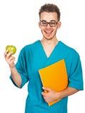 Medico con una mela Fotografie Stock Libere da Diritti