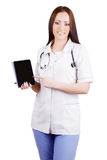 Medico della donna che tiene compressa elettronica Fotografia Stock
