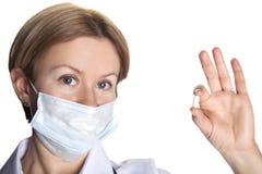 Medico della donna con una pillola Fotografia Stock