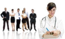 Medico della signora con i colleghi Fotografia Stock Libera da Diritti