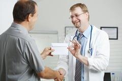 Medico di corruzione paziente Fotografia Stock