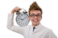 Medico divertente con la sveglia Fotografie Stock