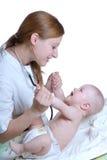 Medico e bambino della donna Fotografia Stock