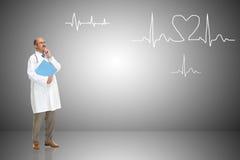 Medico e cardiogramma Fotografia Stock Libera da Diritti