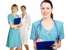 Medico e squadra caucasici attraenti Fotografia Stock Libera da Diritti