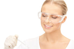 Medico femminile attraente con il termometro Fotografie Stock