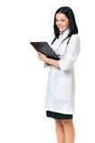 Medico femminile che tiene i appunti fotografia stock