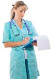 Medico femminile con scrittura della lavagna per appunti isolato Fotografie Stock
