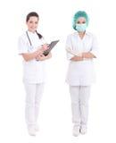 Medico femminile ed infermiere che controllano bianco Fotografia Stock
