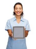 Medico o infermiere femminile sorridente con il pc della compressa Fotografia Stock Libera da Diritti