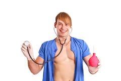 Medico sexy felice con lo stetoscopio ed il clistere Fotografie Stock Libere da Diritti