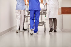 Medics carrying hospital gurney to emergency room. Profession, people, healthcare, reanimation and medicine concept - group of medics or doctors carrying royalty free stock image