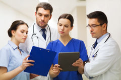 Medics with clipboard and tablet pc at hospital Royalty Free Stock Photography