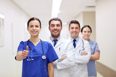 Medics or doctors at hospital showing thumbs up Stock Image