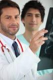 Medics examining an X ray Royalty Free Stock Photo