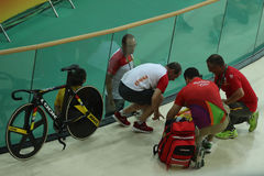 Medics help cyclist Tania Calvo of Spain after her crash during Rio 2016 Olympics women`s keirin first round heat 2. RIO DE JANEIRO, BRAZIL - AUGUST 13, 2016 Royalty Free Stock Photos