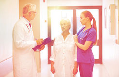 Medics and senior patient woman at hospital Stock Images