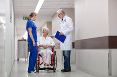 Medics and senior woman in wheelchair at hospital Royalty Free Stock Images