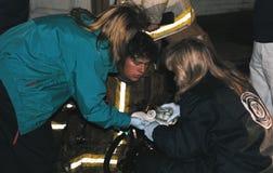 Medics work on injured firefighter royalty free stock image