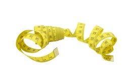 Medida de fita amarela isolada em um branco Imagem de Stock Royalty Free