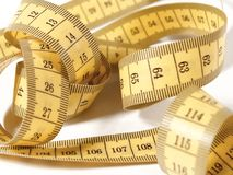 Medida de fita amarela nos centímetros Fotografia de Stock