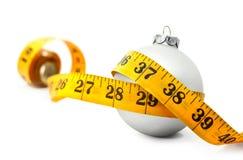 Medida de fita do Bauble do Natal fotos de stock