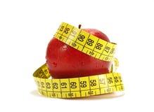 Medida de fita vermelha da maçã Foto de Stock