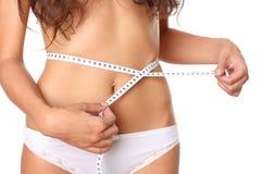 Medida de la cintura femenina Imagen de archivo