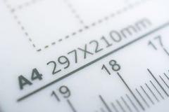 Medidas para el tamaño del papel A4 Imágenes de archivo libres de regalías