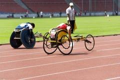 Medidores de raça da cadeira de rodas das mulheres 100 Fotografia de Stock Royalty Free