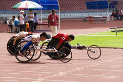 Medidores de raça da cadeira de rodas dos homens 100 Foto de Stock Royalty Free